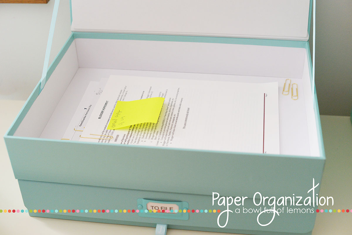 Get control of the paper piles, once and for all...  with this easy tutorial on Paper Organization by A Bowl Full of Lemons